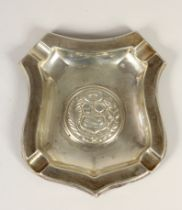 A silver ash tray, stamped STERLING 925, embossed with a family crest, 14 x 13cm, 2.5oz