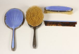 A silver and blue guilloche enamel four piece dressing table set, Birmingham 1936, mirror, two