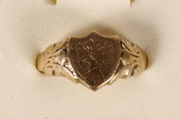 A 9ct gold shield shape signet ring, Birmingham 1971, Y, 8.3gm