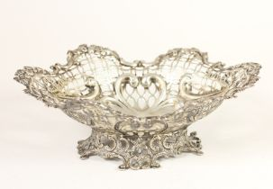 A Victorian silver pierced and embossed bowl, by William Comyns, London 1891, raised on a cast base,