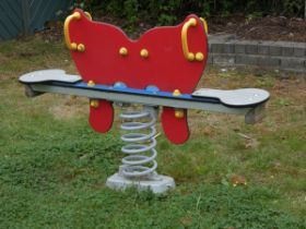 A Playdale outdoor/playground springer seesaw in the form of a butterfly, made from high density