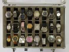 A collection of twenty four quartz ladies and gents wristwatches, makers to include Timex, Casio,