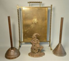 An early cast iron door stop of Mr Punch 31cm tall, together with copper ponsh's, brass planter,