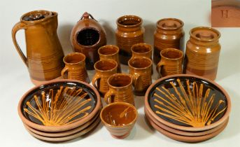 A collection of Studio Pottery glazed terracotta kitchen ware to include, lidded storage jars,