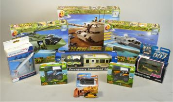 A substantial collection of tractor monthly magazines, together with boxed model sets H.M Armed