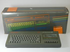 A ZX Spectrum +2, boxed with power supply and TV lead and manual, together with a Sinclair ZX81