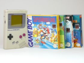 A Nintendo Gameboy, with four boxed games including MegaMan II, Rad'n'Bad, Simpsons - Escape from