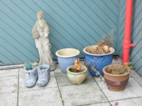 A collection of glazed garden planters together with a composition stone figurine 81cm and novelty