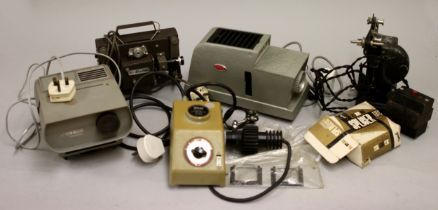 A collection of projectors, both film reel and 35mm slides