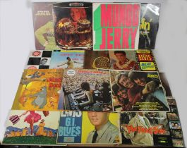 A collection of 11 The Beatles books and a vinyl LP/33 record 'The Beatles Rock 'n' Roll volume 1,