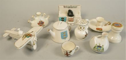A Willow Art/Carltonware model of a WW1 aircraft, together with eight other souvenir crested china