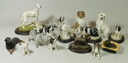 A collection of handcrafted model dogs together with ceramic fruit bowls, glass vases and an early