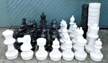 A Rolly Toys giant PVC garden chess and draughts set, lacking one black draught, king 60cm,