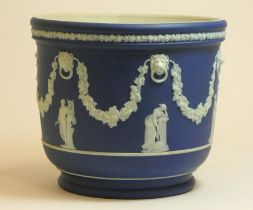 A Wedgwood blue Jasperware Jardinière Cache Pot, decorated with vines and Roman figures, height 20cm