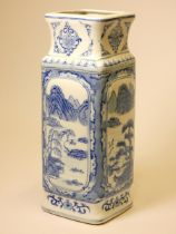 A Chinese blue and white vase, decorated with scenes depicting Oriental landscapes, height 36cm