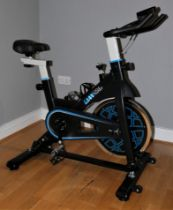 A Lean cycle trainer exercise bike, with manual and tools https://www.idealworld.tv/gb/common/