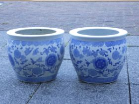 A Chinese pair of blue and white glazed jardinière pots, height 26cm, diameter 30cm.