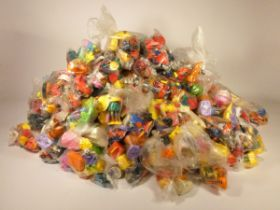A collection of 200 sets of four (800) McDonalds happy meal toy sets from the 1980s and 1990s, to