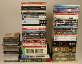 A collection of DVDs including box sets of wartime dramas and documentaries