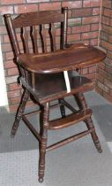 A child's highchair, together with a set of four cast iron Heritage Bathrooms Imperial Bath Feet,