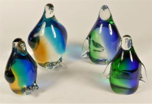 A collection of four limited edition coloured glass penguin paperweights (boxed), no. 1273/1500,