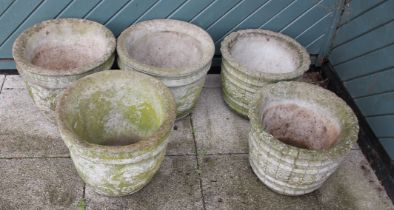 Five composite garden planters, with floral and barrel decoration, 35cm height (5)