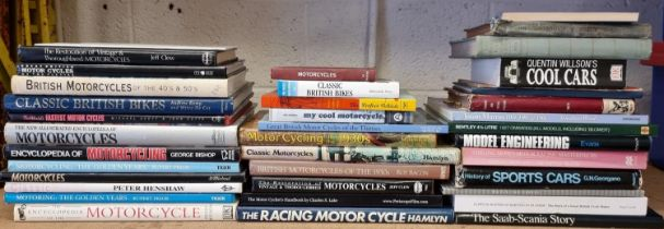 A collection of motorcycle and motorcar related books, including The Sports Car by John Stanford