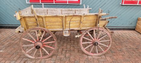 A farm cart, with artillery wheels wheels and shafts