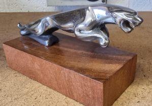 A Jaguar Mk2 leaping cat mascot, 18cm, mounted on a hardwood base.
