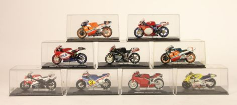 A collection of 9 model motorcycles