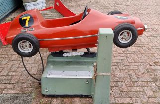 A RGM Red Flash coin operated Ferrari red race car amusement machine, c.1960/70's. Sold as seen,