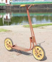 A MOBO child's red and yellow scooter