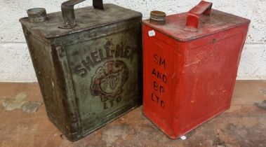 A Shell-Mex petrol can and another, both lacking caps