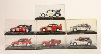 A collection of 7 boxed model rally cars