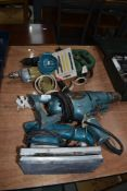 A selection of vintage electric hand tools including sander drill driver jigsaw etc