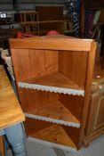 A natural pine corner shelf
