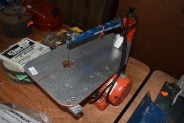 A modern Hegner scroll or fret saw for model making or workshop