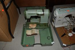 An Elna supermatic apple green sewing machine for haberdashery or dress making