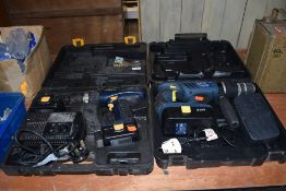 Two battery operated cordless drivers one large hammer drill and smaller screw driver