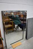 A modern frameless wall mirror, approx. 80 x 120 cm