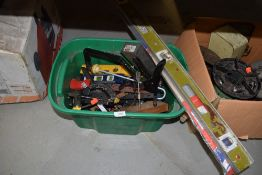 A selection of workshop or DIY tools including clamps and grips