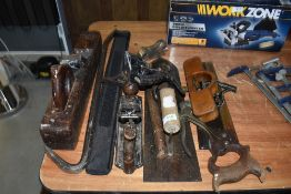 A selection of wood working tools including hand plane Spear and Jackson saw and large float