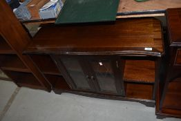 A reproduction Regency style low display unit with central display section flanked by shelves, width
