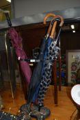 A reproduction cast umbrella stand