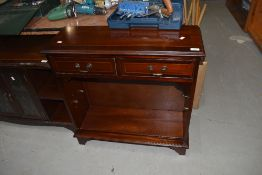 A reproduction Regency style low shelf unit with two frieze drawers, width approx. 76cm
