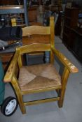A heavy rush seated carver chair