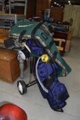A selection of golf equipment including various balls tees clothes, Set Ladies Howson Derby clubs,