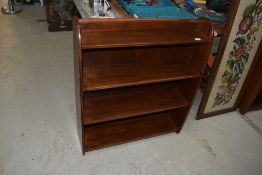 A mid 20th Century stained frame low bookshelf, width approx. 76cm