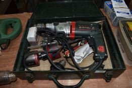 A Metabo cordless drill in metal case