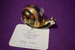 A Royal Crown Derby paperweight Garden Snail with gold stopper and certificate